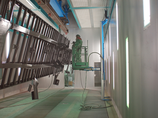 Wall-Man pneumatic man lift painting of trailers